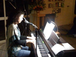 Image of Katie de Veau providing music at one of her spiritual retreats